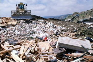 Landfill site with yellow bulldozer